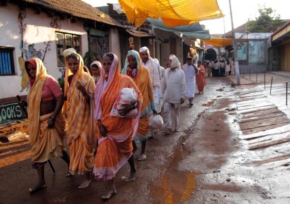 Pilgrims making their way to the beach for a ritual dip