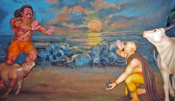 Ganesha, disguised as a Brahmin boy, puts down the Atmalinga, from a representation of the story at Murudeshwar