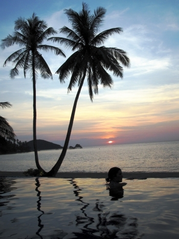 Claire in Koh Mak Resort's infinity pool at sunset