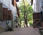 Open shutter and doors in a Luang Prabang lane
