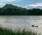 A solitary boat where the Nam Khan meets the Mekong