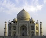 The Taj Mahal is built on a platform, which raises it above the crowds and gives the sense that it is much larger that it really is