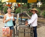 Buying coconut ice-cream at Wat Simuang