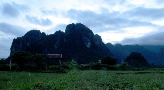 A karst mountain behind the paddy fields in Vang Vieng, Laos